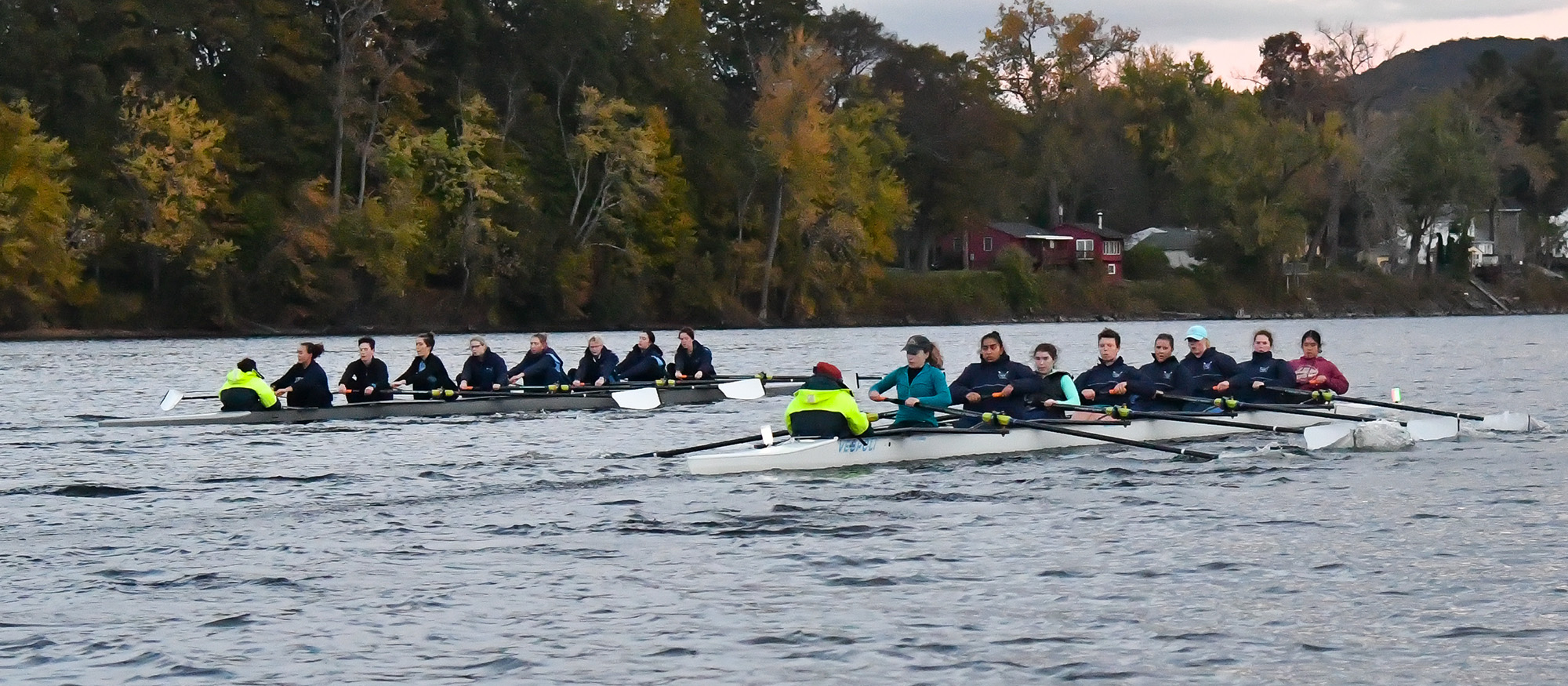 Photo of two Lyons Rowing crews practicing on the Connecticut River.