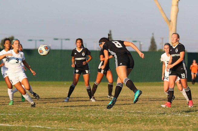 Elizabeth Mendez heads home the Falcons first goal in a 2-0 win