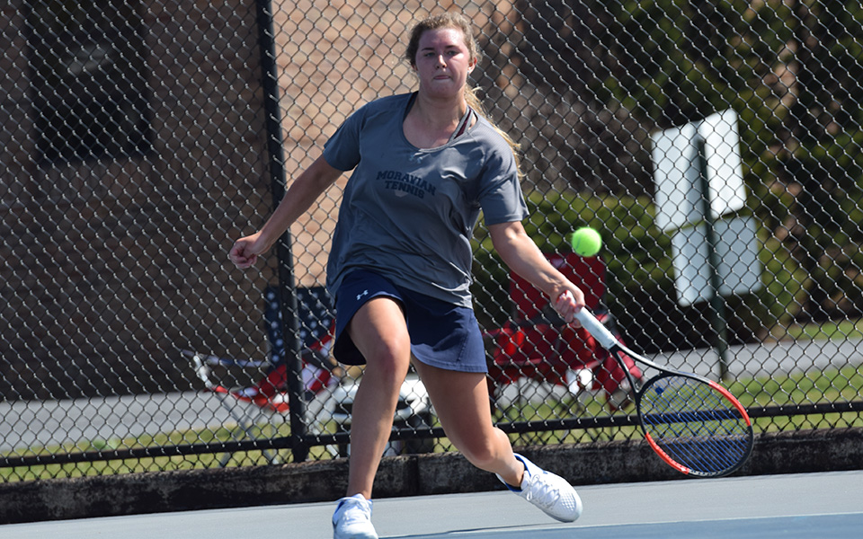 Sophomore Emma Angle returns a shot during singles action versus The Catholic University of America at Hoffman Courts.