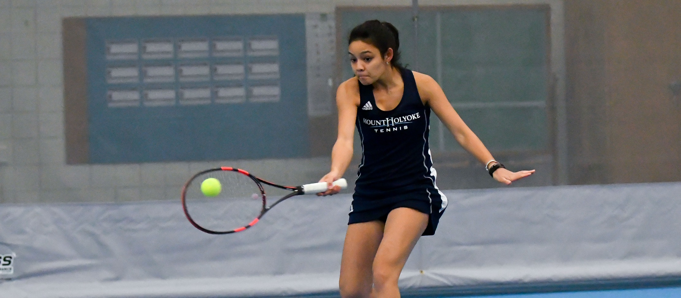 Action photo of sophomore tennis player Catherine Peabody.