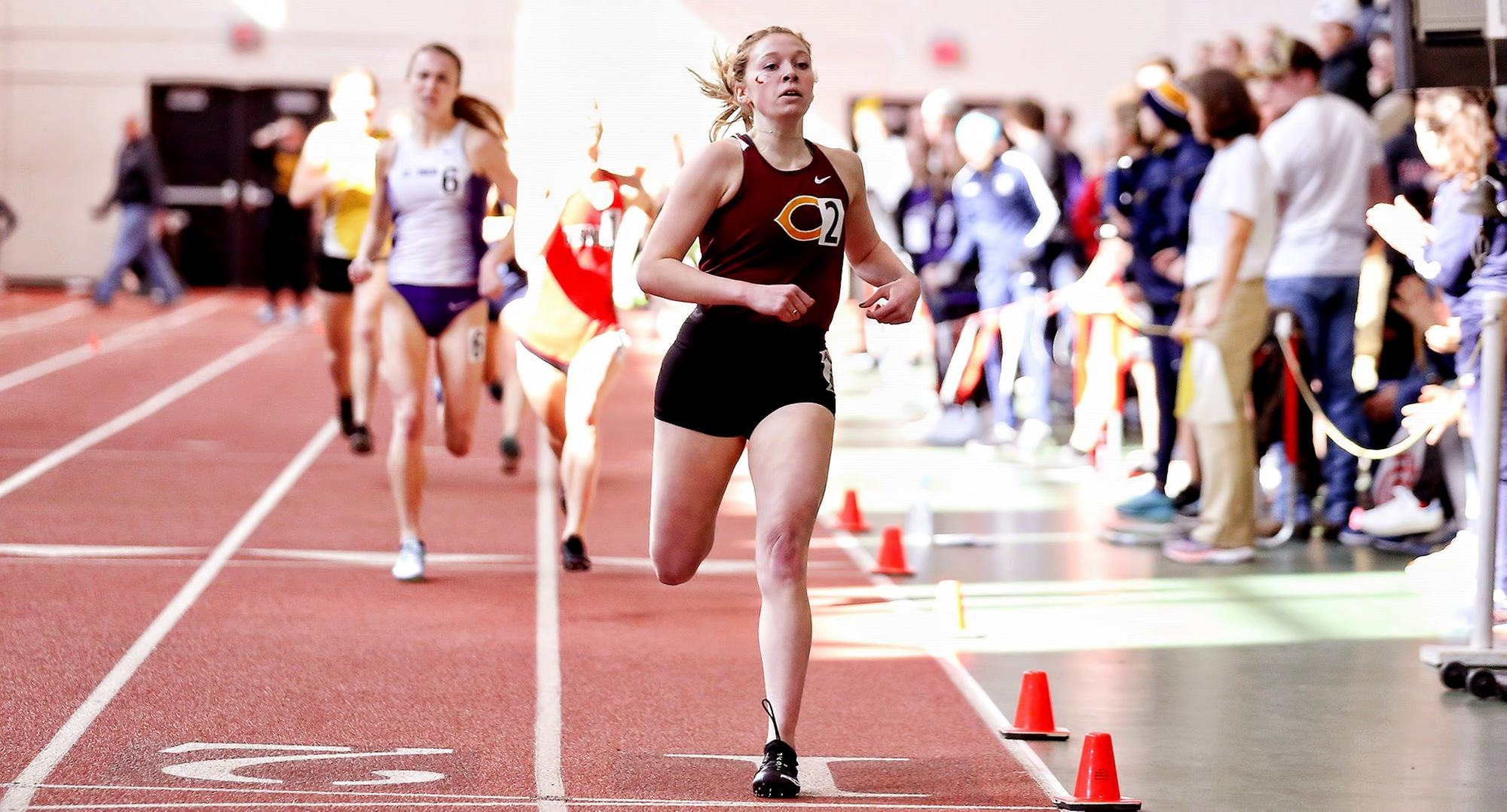 Josie Herrmann crosses the finish line first in the 1000 meters after breaking the school record at the MIAC Indoor Meet.