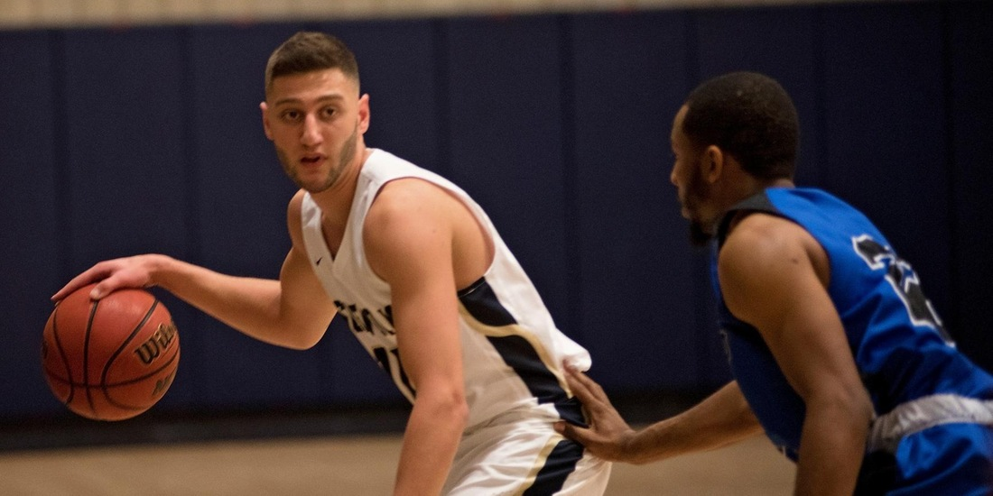 Men's Basketball Tripped Up On the Road at JWU