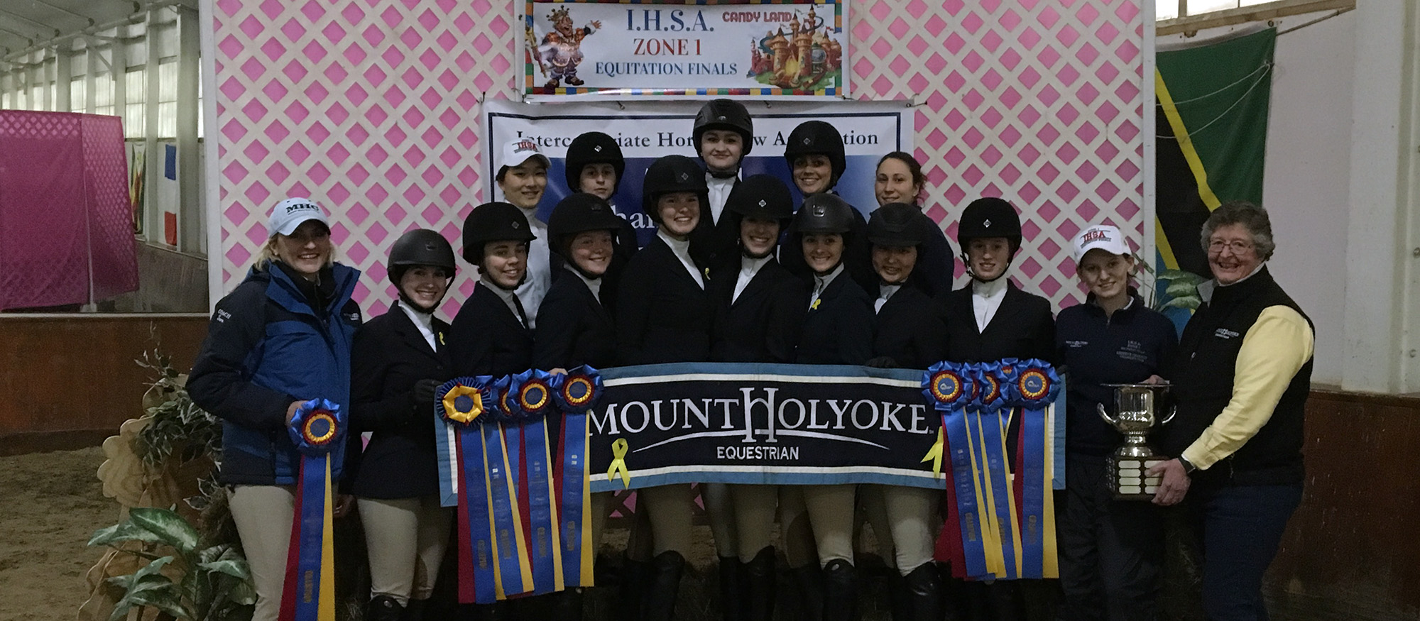 The Mount Holyoke Riding Team poses after winning the 2018 Zone 1 Championship to earn a trip to the IHSA National Championship.