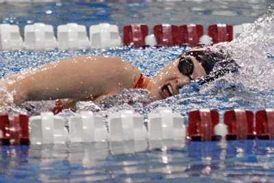 Swim teams split at Coe