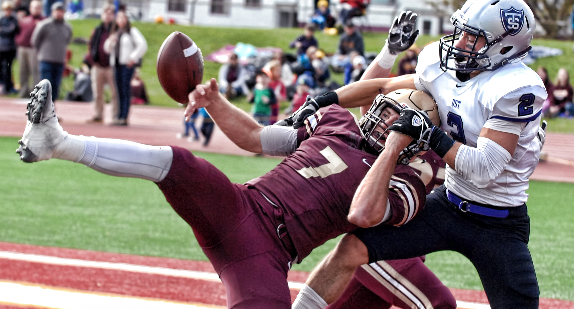 Junior defensive back Dallas Raftevold tries for the interception during the Cobbers' thrilling Homecoming game with  #4 St. Thomas.