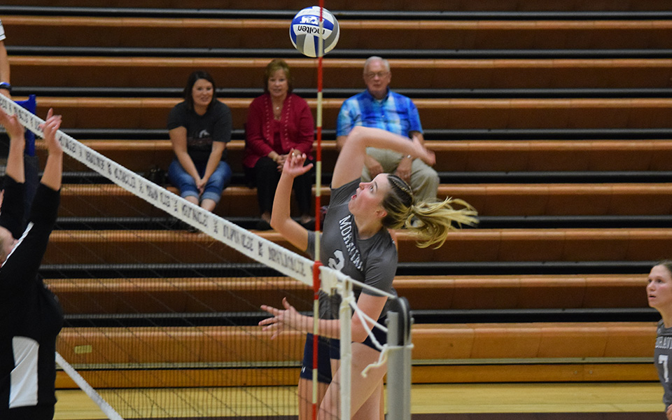 Sophomore middle blocker Jess Appleton goes up for an attack attempt versus Lancaster Bible College in Johnston Hall.