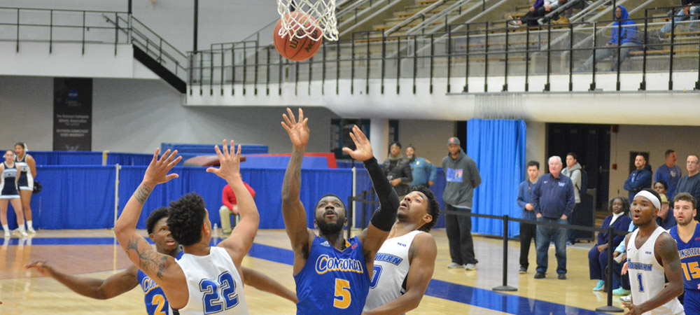 McFadden Scores 1,000th Career Point In Men's Basketball's 69-66 Setback At Holy Family