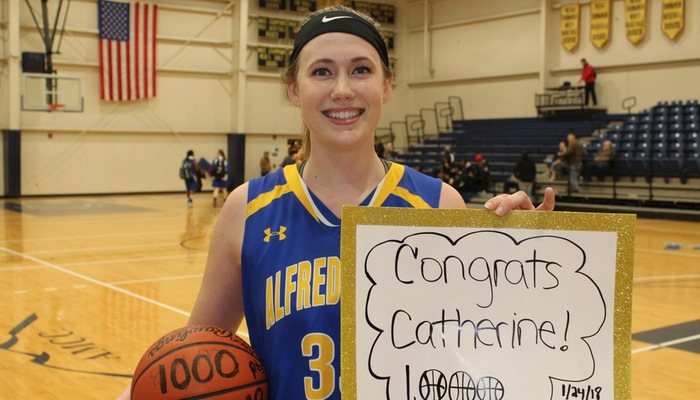 Catherine Bialecki after scoring her 1,000th point of her career