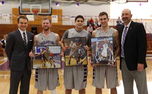Justin Klingman (2nd from left), Michael Fee (center) and Ross Danzig (2nd from right) were honored as part of Senior Day festivities at the Long Center prior to today's game against Elizabethtown.  Also on hand were asst. coach Joe Michalich (left) and head coach Carl Danzig (right).