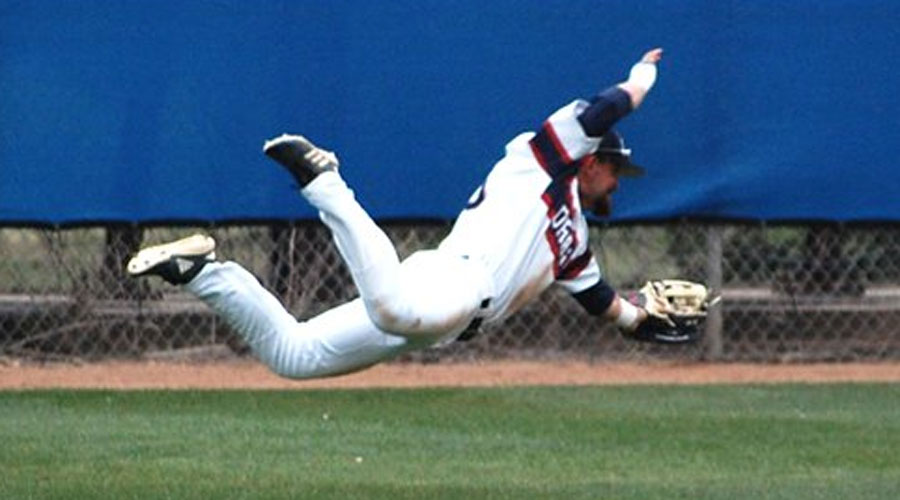 Riley Metzger makes a tremendous diving catch in the seventh inning of Hutchinson's 3-2 victory over Barton on Tuesday at Hobart-Detter Field. (Casey Bailey/Blue Dragon Sports Information)