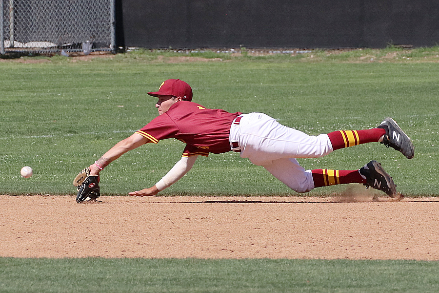 Lancers shortstop Ryan Lewis makes the diving catch on this liner before it could reach the dirt on Wednesday, photo by Richard Quinton.