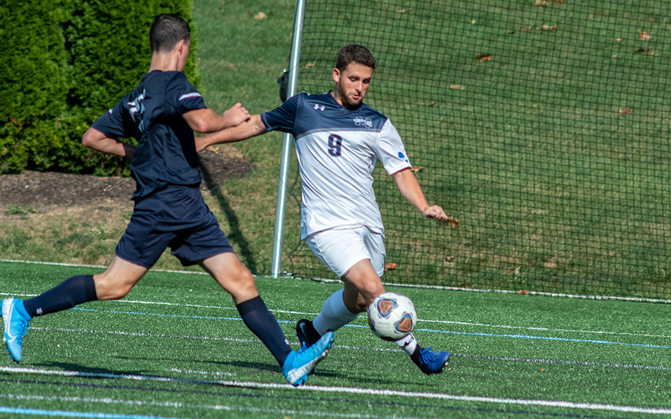 Senior Kenny Fellows plays a ball into the box in a match versus Wilkes University on John Makuvek Field.