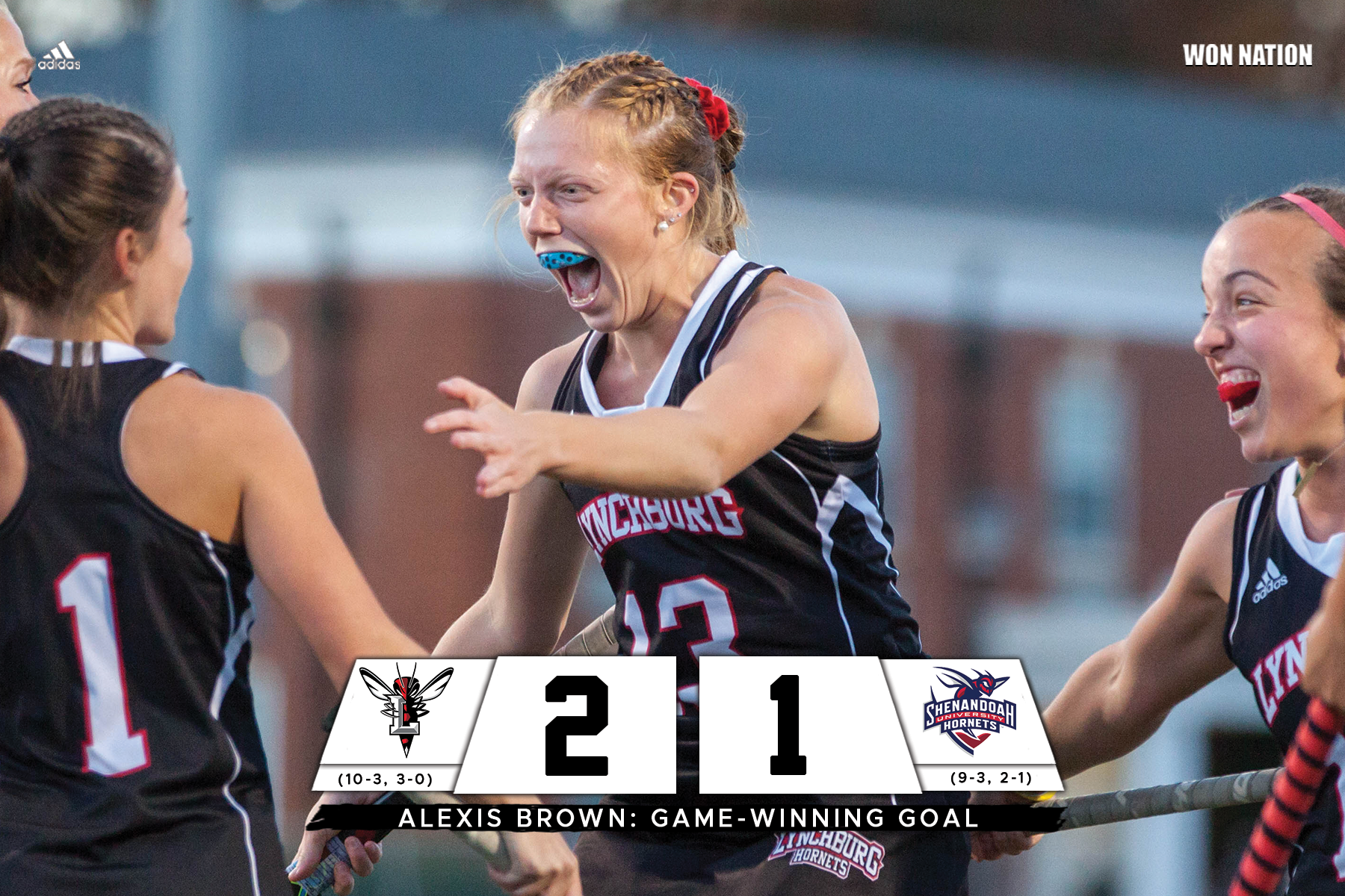 Alexis Brown and the Hornets celebrate a field hockey goal