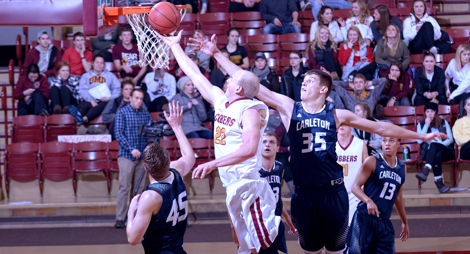 Junior Dawson Peterson drives to the basket to lay in two of the Cobbers' 63 points in CC's eight-point win over Carleton.