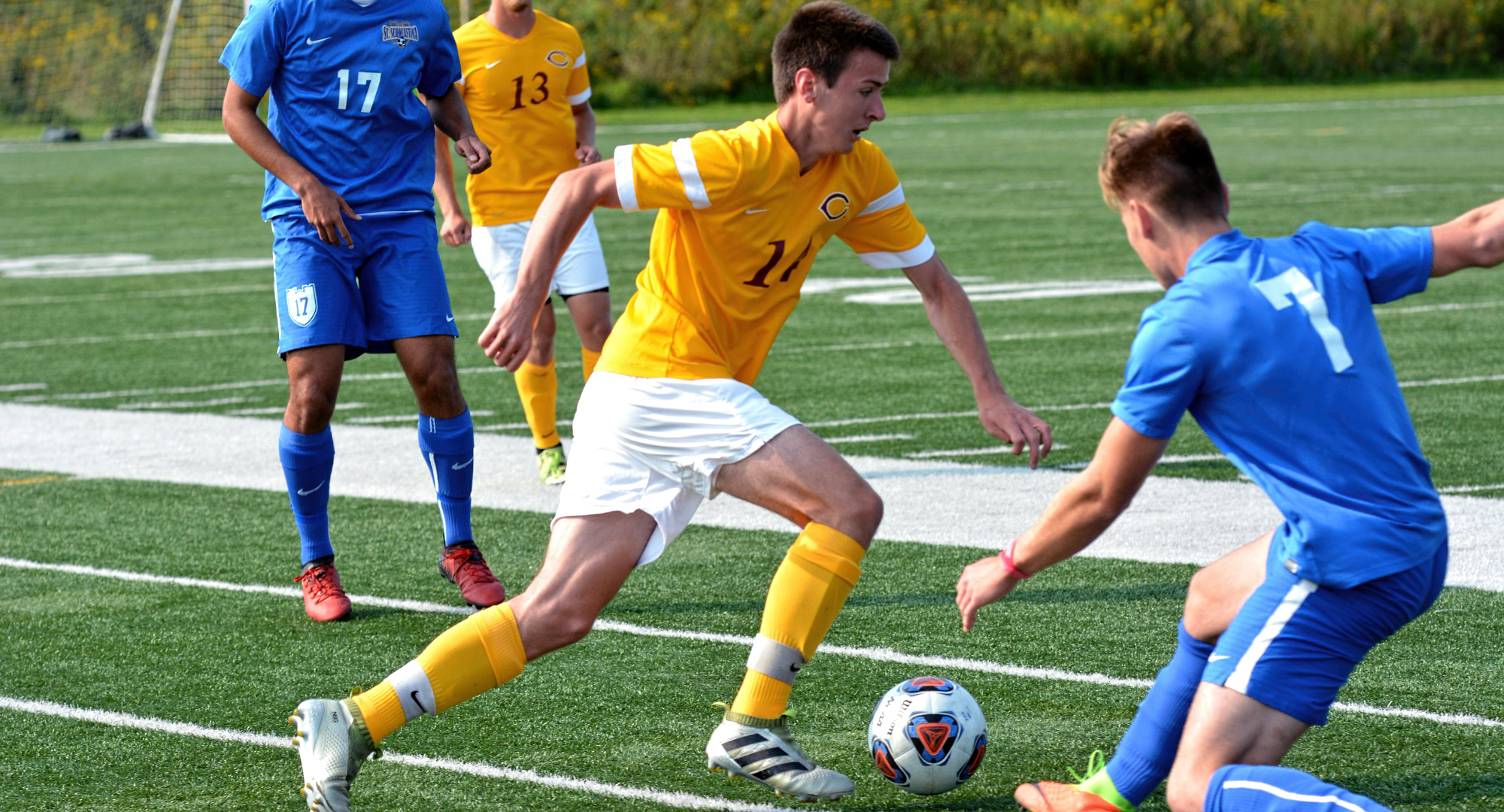 Sophomore Noah Gjesdahl eludes a St. Scholastica during the Cobbers' opening weekend of play. (Photo courtesy of St. Scholastica Sports Info Department)