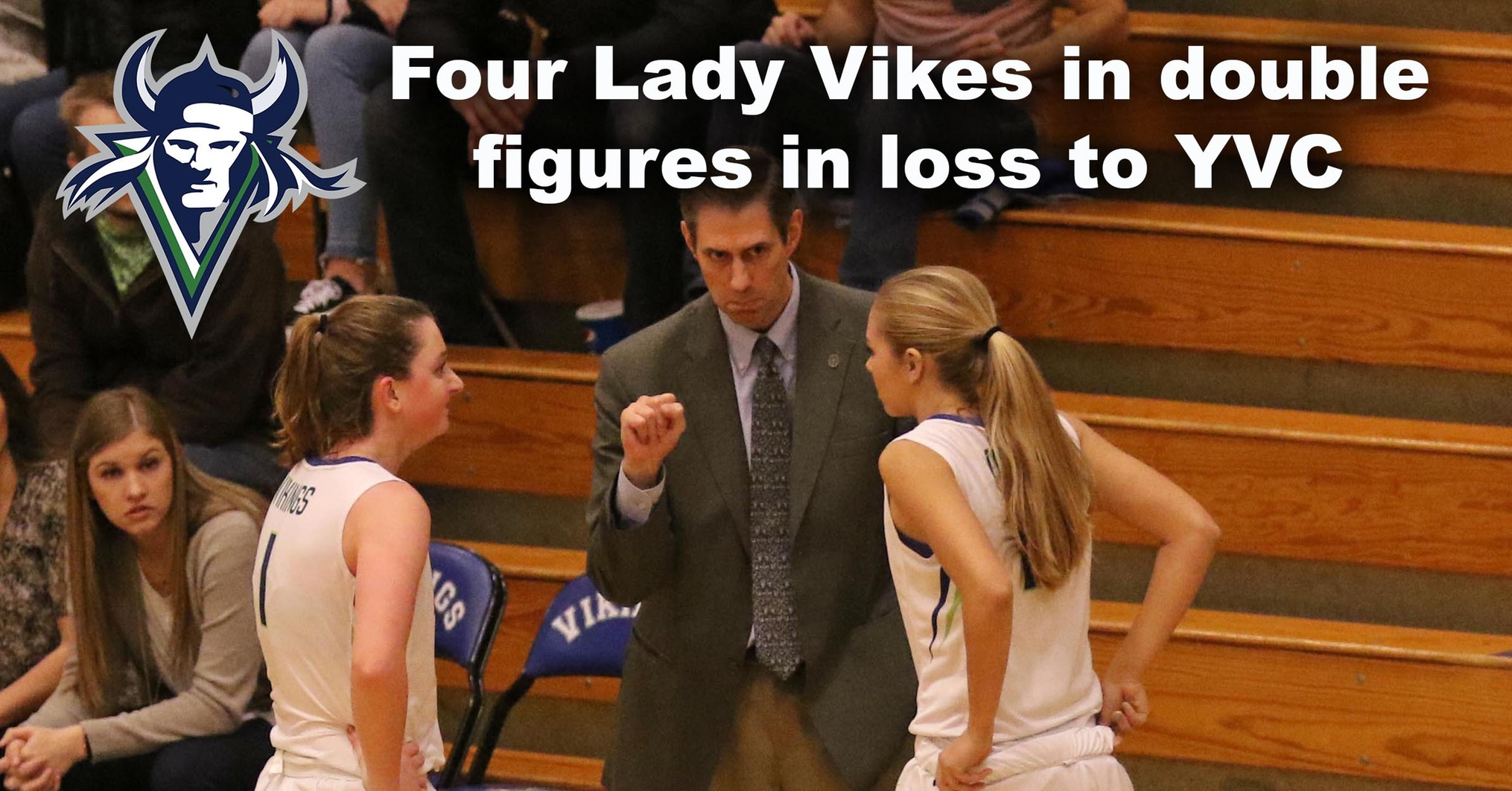 Lady Vikings Head Coach Preston Wilks talks to his players during a break in the action.