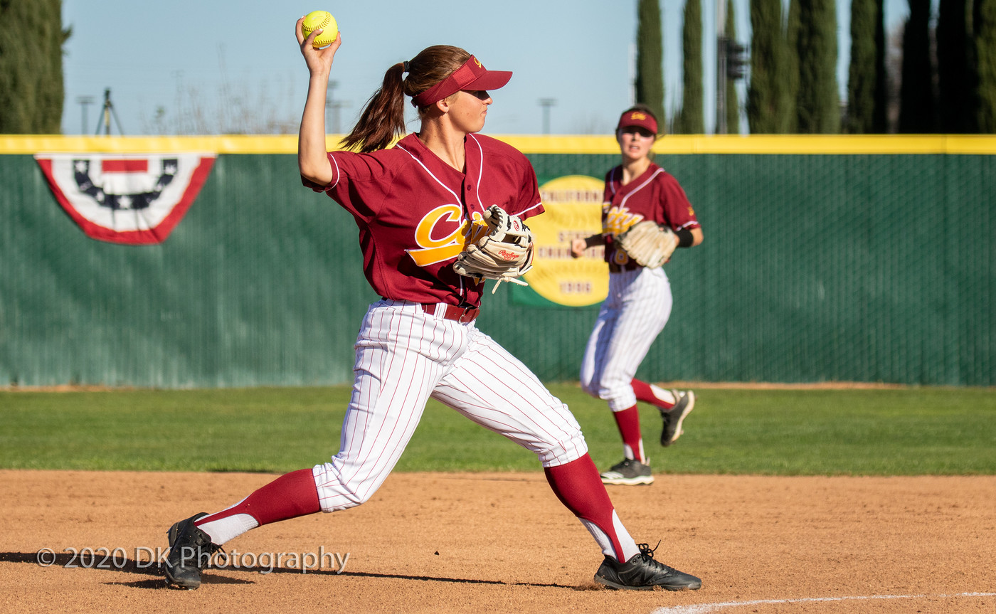 Mia Santos (#12), City College sophomore makes the throw to first for the out in the second game of a double header against Merced College at The Yard on Feb. 11th.