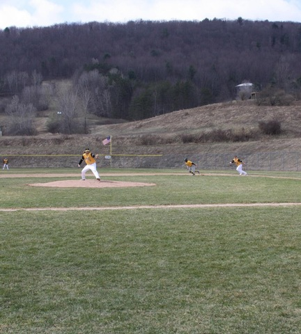 Broome pitching ball with runner stealing second
