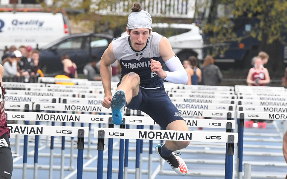Senior John Spirk clears a hurdle in the 110-meter high hurdles in the Greyhound Invitational at Timothy Breidegam Track.
