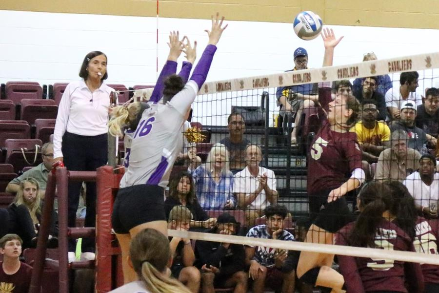 Cavs Tap Out Trojans In Three Sets