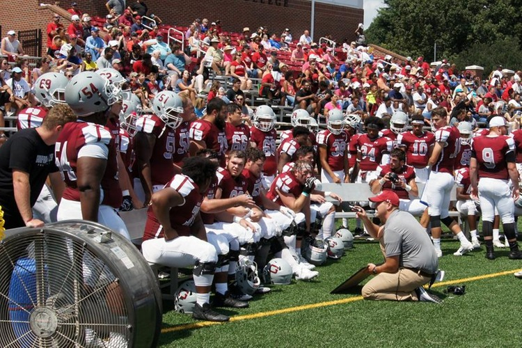 Coach Brad Davis '08 coaches the Quakers' offensive line. (John Bell photo, Touch A Life Photography)