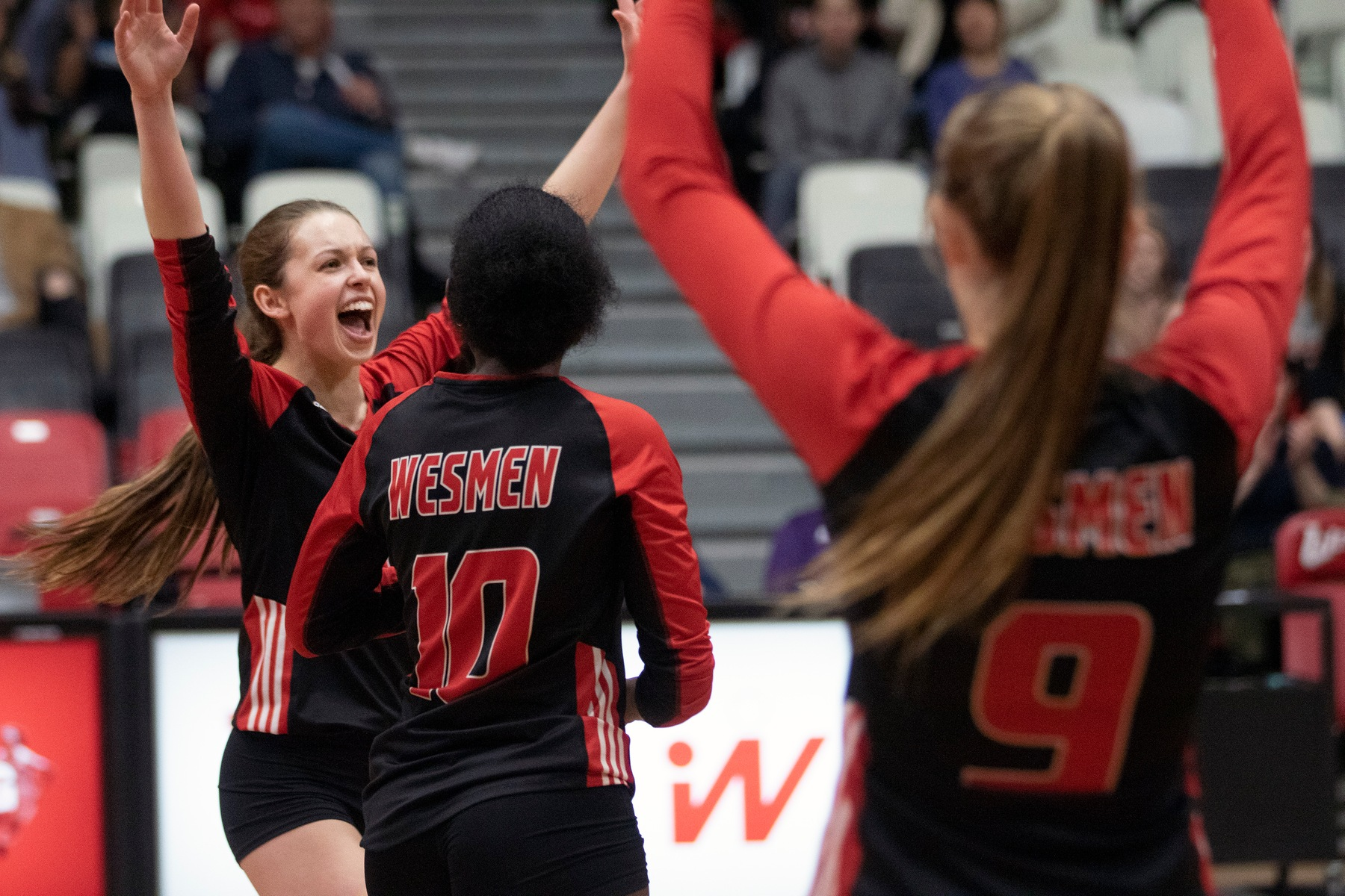 The Wesmen women's volleyball team celebrates a point in the first set of a victory over the Calgary Dinos in a women's volleyball match Saturday, Feb. 8, 2020. (David Larkins/Wesmen Athletics)