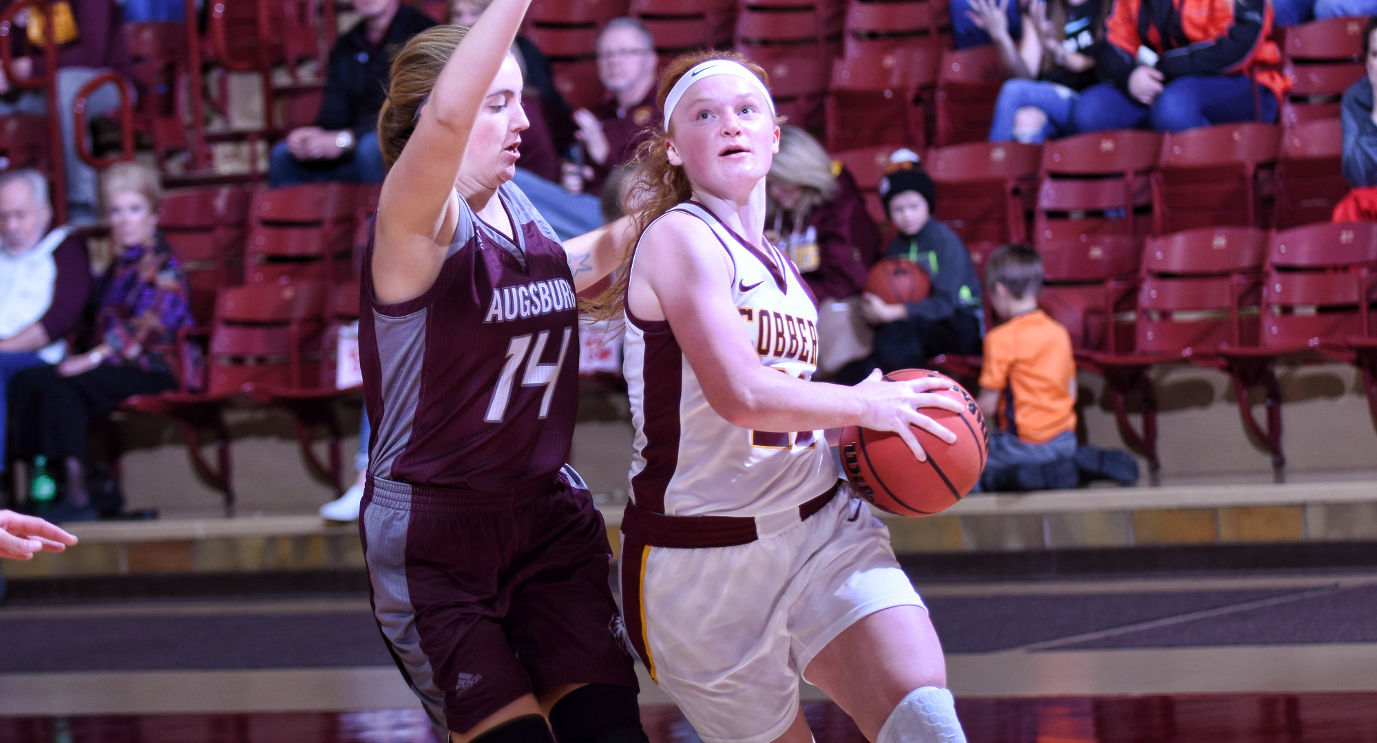 Junior guard Rachel Hoernemann drives to the basket in the first half of the Cobbers' MIAC opener against Augsburg. She had a team-high four assists.