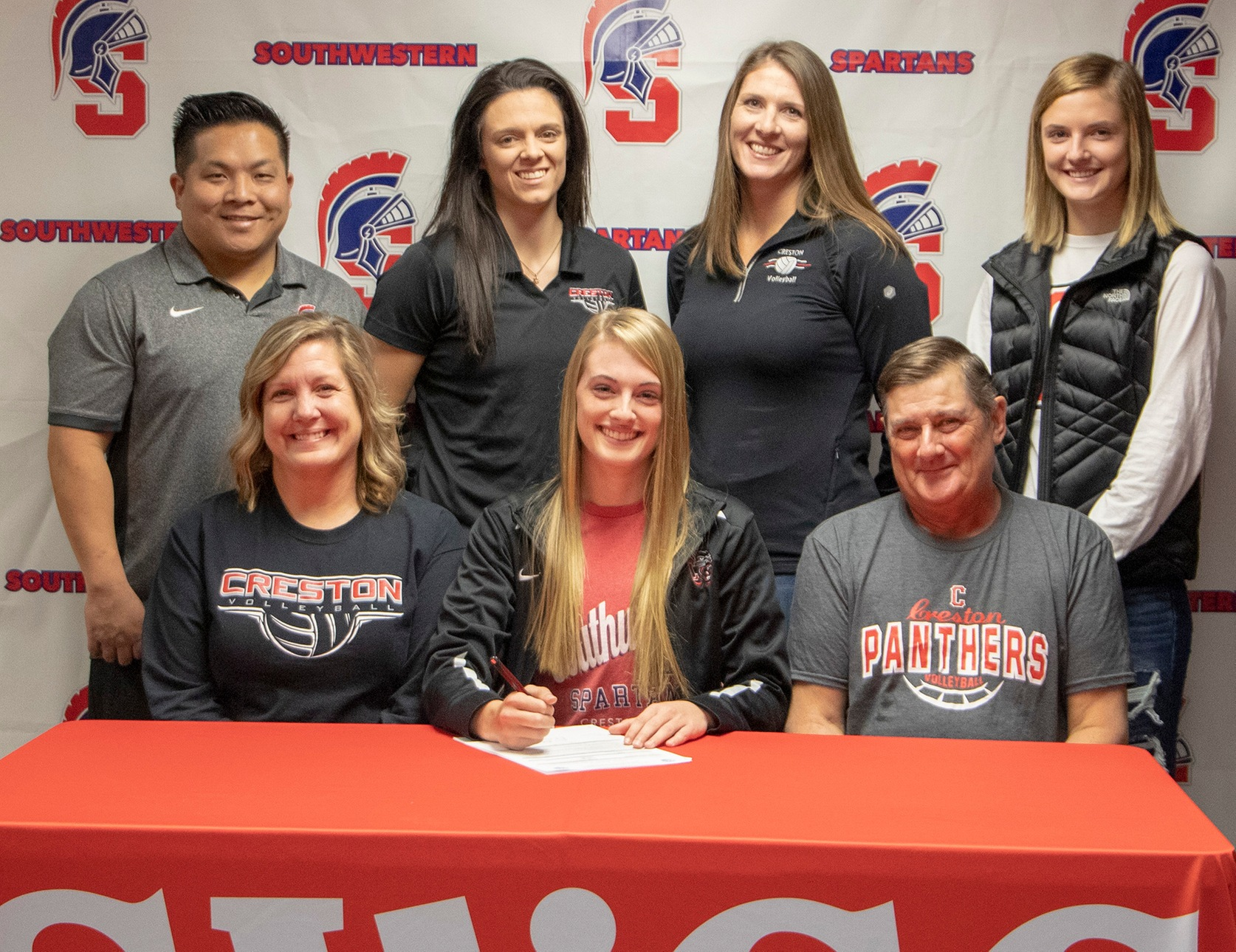 PHOTO CUTLINE (L to R): Sitting – Stacey Buxton, Taylor's mother; Taylor Buxton; and Greg Buxton, Taylor's father. Standing – Casey Quiggle, Southwestern head volleyball coach; Mallory Peterson, Creston High School volleyball coach; Naomi Sharp, Creston High School volleyball coach; and Morgan Buxton, Taylor's sister.