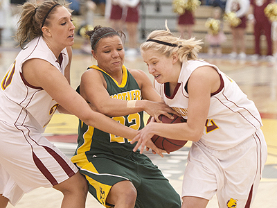 FSU's Andrea Clancy & Sarah DeShone battle for the ball against NMU (Photo by Ed Hyde, FSU Photo Services)