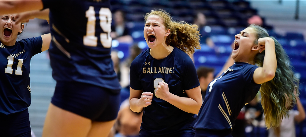 Gallaudet women's volleyball player Cassidy Perry is excited after the Bison won its match.