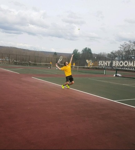Broome player serving