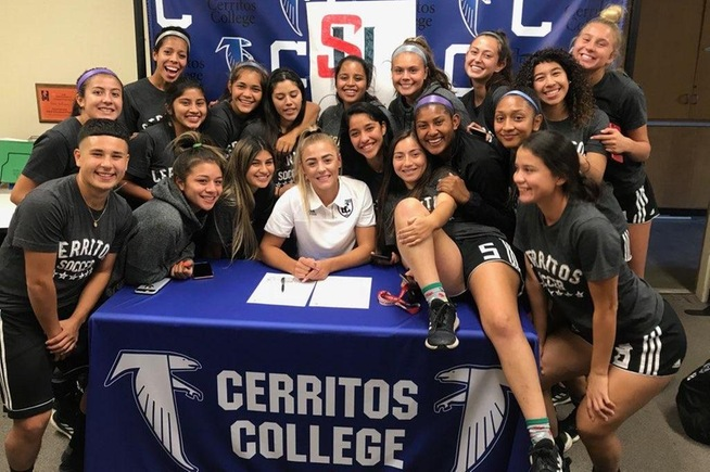 Sydney Carr is joined by her teammates as she signs with Seattle University