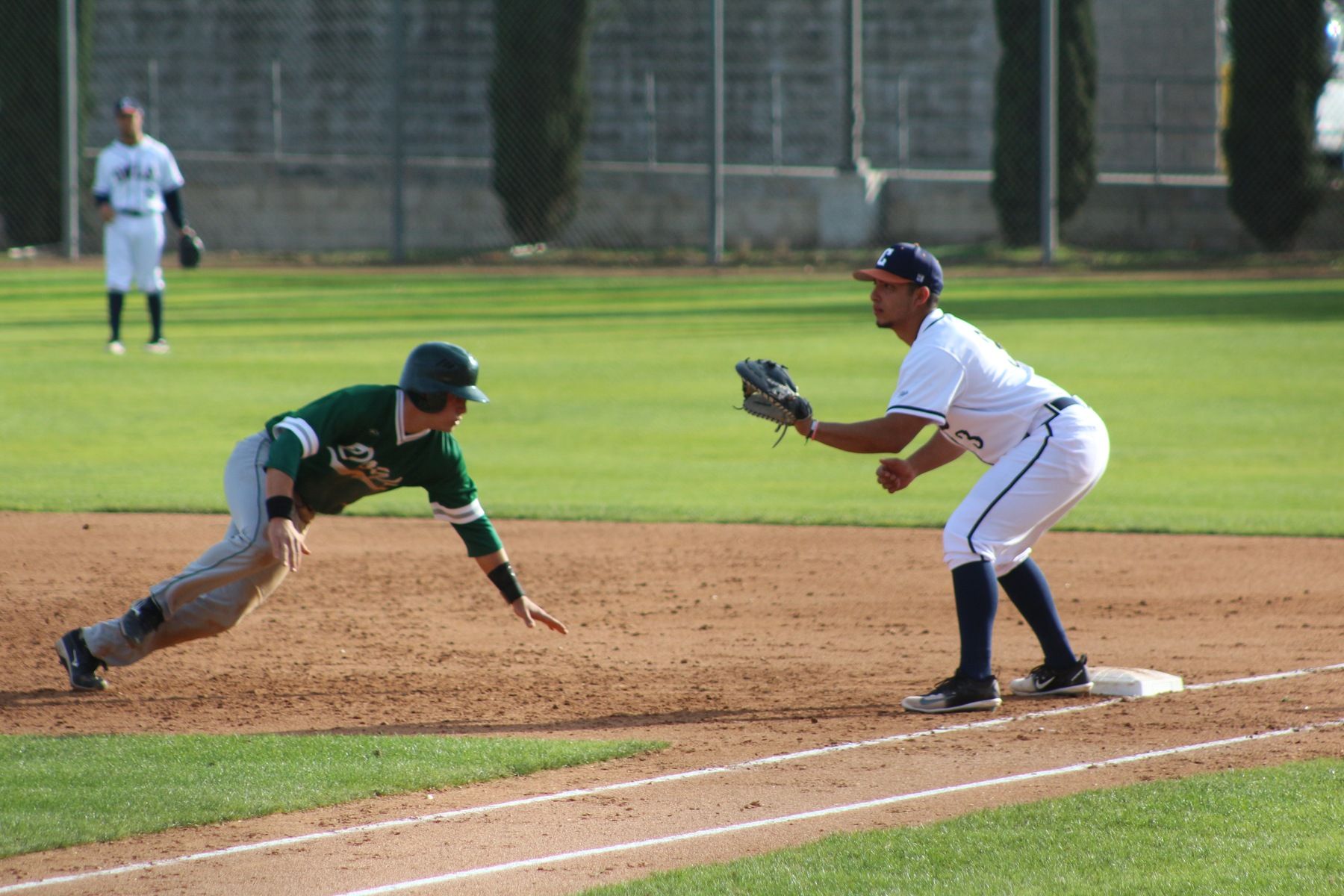 Jesse Villalobos holds the opposing runner at first.
