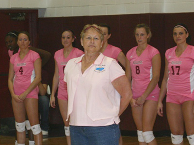 Cancer survivor Terri Bloomquist is honored by the FSU Volleyball Team prior to their DiG PiNK match. (Photo by Sandy Gholston)