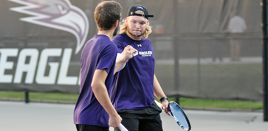 Cason and Johnson celebrate a 8-4 win at No. 3 doubles against Hendrix College.
