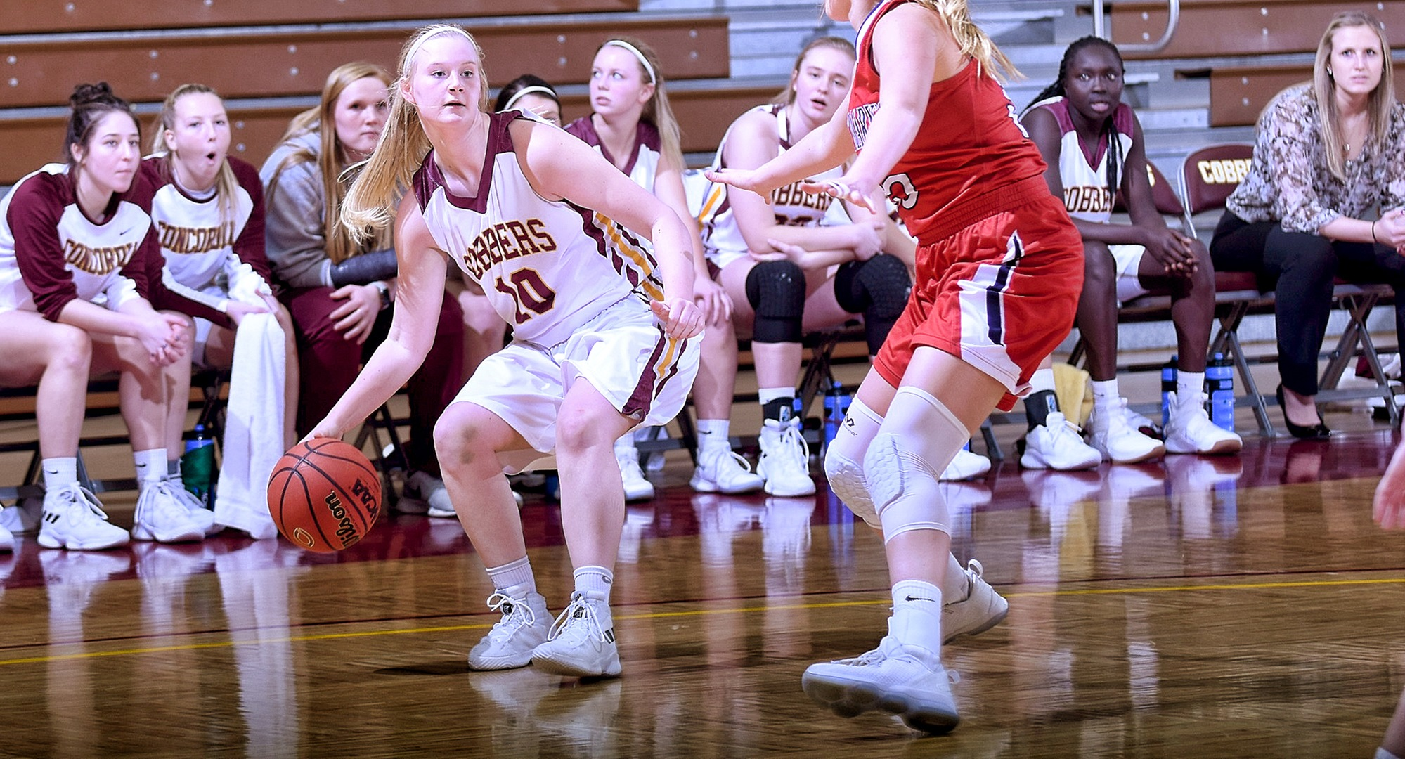 Sophomore Elizabeth Birkemeyer  dribbles the ball towards the basket in the second half of the Cobbers' game with St. Mary's. She finished with career-high totals in points, rebounds and assists.