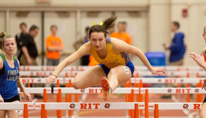 Emily Brigman goes over a hurdle