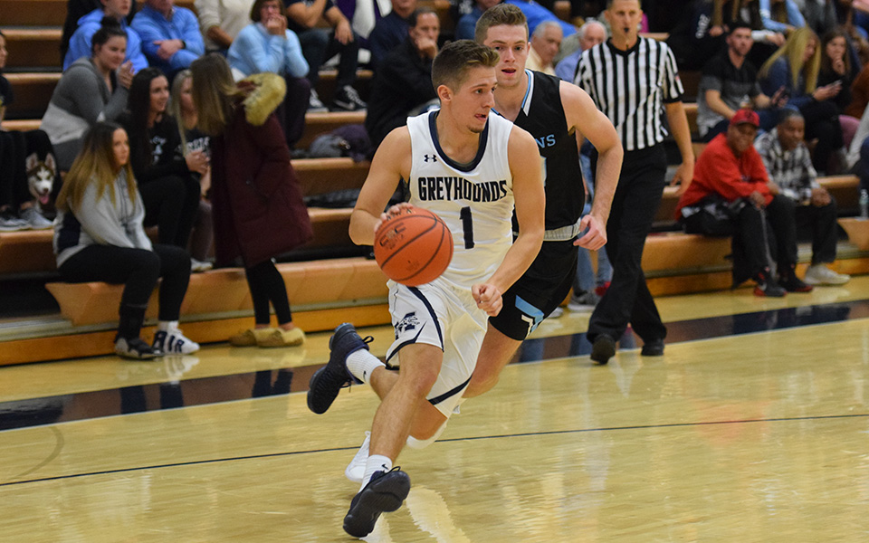 Sophomore guard Keith Otto drives down the baseline versus No. 15 Johns Hopkins University in Johnston Hall.