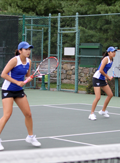 Blue Tennis Downs Clark, 8-1