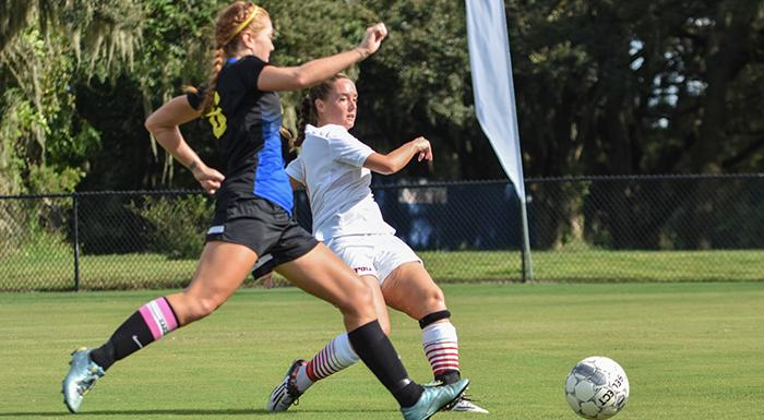 Kelsey Lewis scores one of her three first-half goals in a 7-0 win over Trinity Baptist. (Photo by Tom Hagerty, Polk State.)