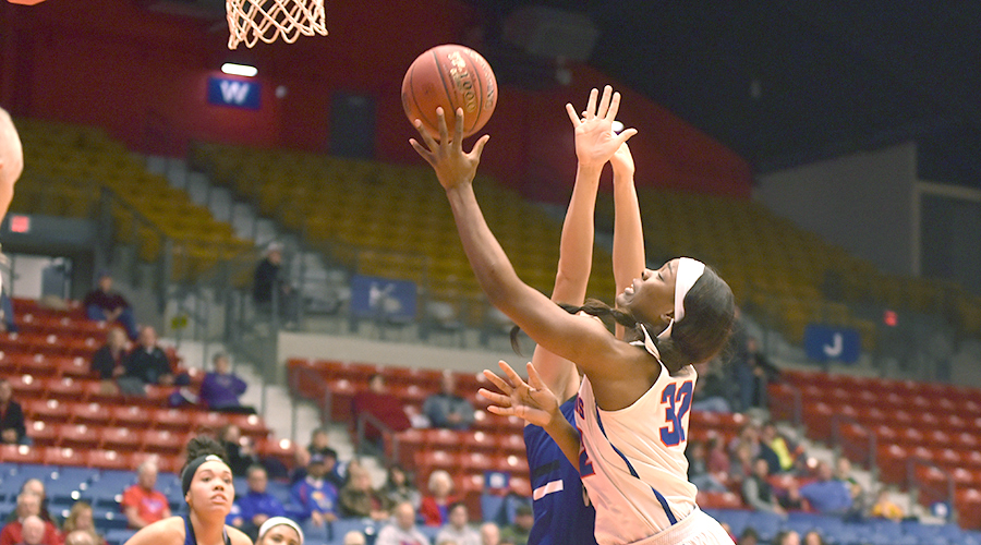 Jada Mickens goes up for a bucket in the third quarter of Friday's 71-50 victory by the No. 6-ranked Blue Dragons over Iowa Western in the Polo Bar & Grill/Blue Dragon Holiday Classic at the Sports Arena. (Andrew Carpenter/Blue Dragon Sports Information)