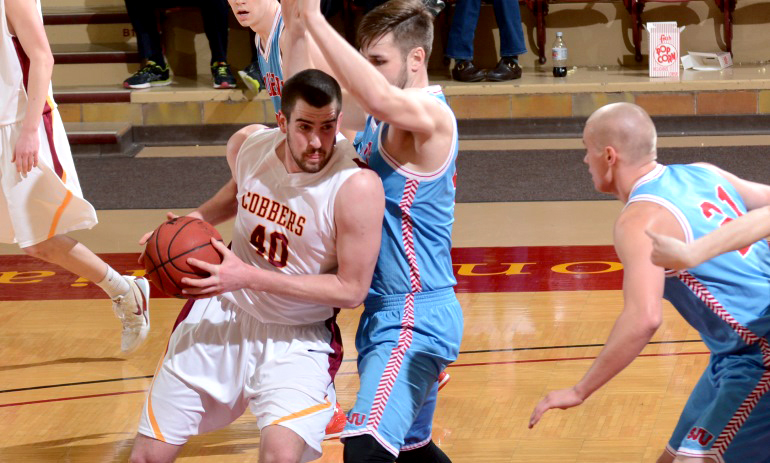 Senior Scott Flotterud drops his shoulder and drives to the basket for two of his six points in the Cobbers' game with St. John's.
