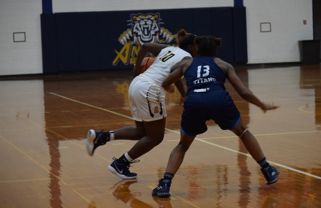 Toddrianna Isler (10) Drives to the Rim