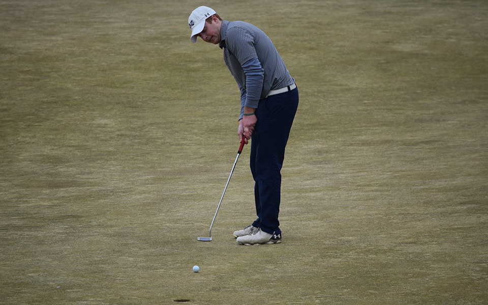 Nick Kuhn putts during the 2018 Moravian Spring Invitational at Southmoore Golf Course