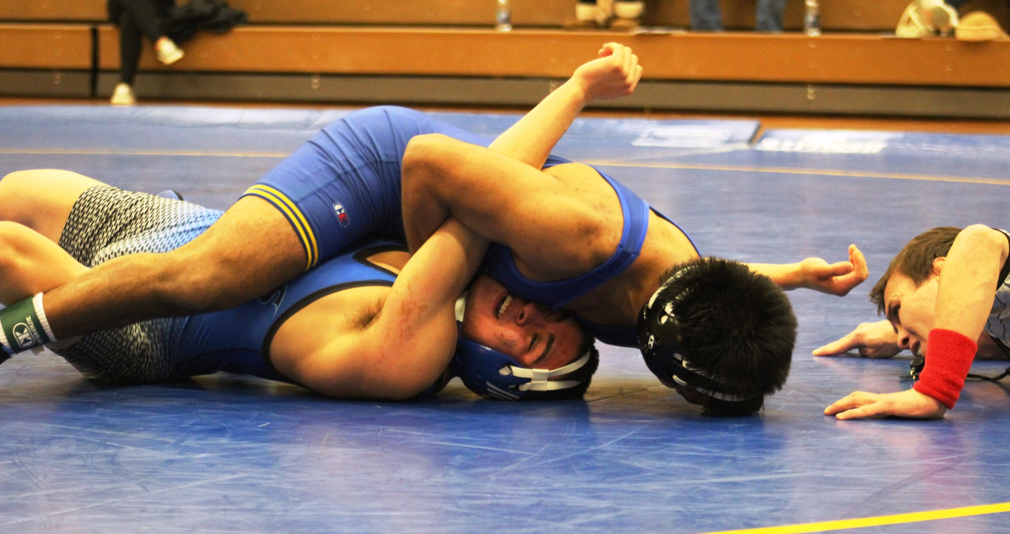 NIACC's Tony Mendoza pins Iowa Western's Melvin Hernandez in their 149-pound match Wednesday in the NIACC gym.