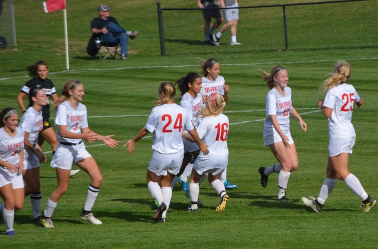 Comets celebrate Emma Essen's goal.