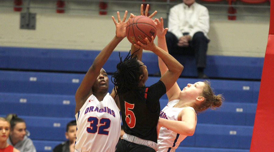 Jada Mickens and Abby Ogle defend against the shot of Allen's Jakira Wilson in the first half of Wednesday's Region VI opening-round 89-40 Blue Dragon win over the Red Devils at the Sports Arena. (Bre Rogers/Blue Dragon Sports Information).
