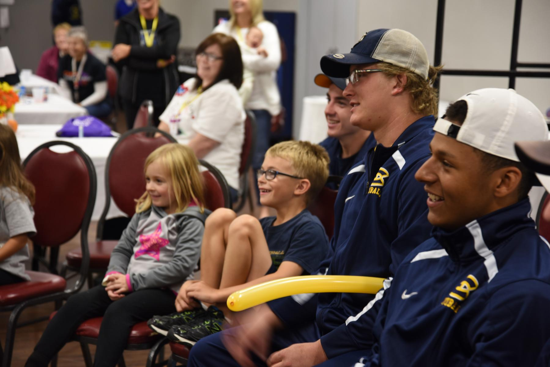 Football Players Partner with Joshua's Camp for Fall Program Event