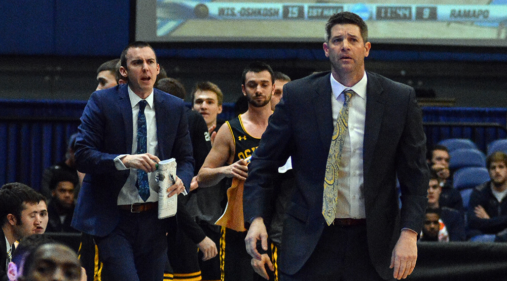 Jason Lewis, in the background, and Pat Juckem, foreground, coaching UW-Oshkosh in last year's national semifinals. (Photo by Dave Hilbert, d3photography.com)