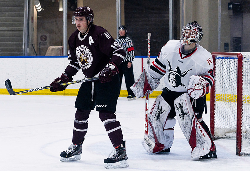 Ryan Baskerville screens UAlberta-Augustana goalie Zach deGraves during a game last weekend. He has 14 points in the first 10 games of the ACAC season for MacEwan (Matthew Jacula photo).